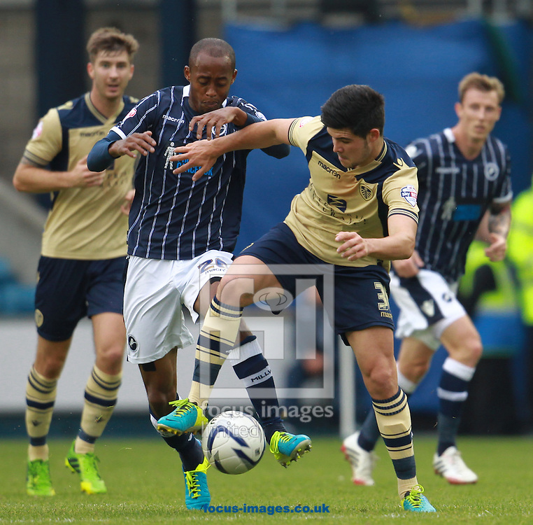 Picture by John Rainford/Focus Images Ltd +44 7506 538356<br /> 28/09/2013<br /> Jimmy Abdou of Millwall and Alex Mowatt of Leeds United during the Sky Bet Championship match at The Den, London.