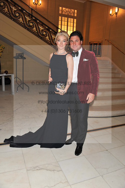 TAMARA BECKWITH and GIORGIO VERONI at the 50th birthday party for Patrick Cox held at the Café Royal Hotel, 68 Regent Street, London on 15th March 2013.