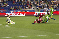June 13, 2018 - Harrison, New Jersey, United States - Goalkeeper Stefan Frei (24) of Seattle Sounders saves during regular MLS game against New York Red Bulls at Red Bull Arena Red Bulls won 2 - 1  (Credit Image: © Lev Radin/Pacific Press via ZUMA Wire)
