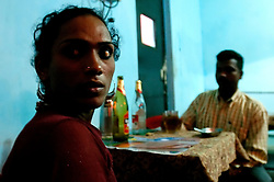 "Transgender sex worker drinks with her client in Villupuram, India. As transgenders,""hijras"" in local terms, are acutely marginalized in Indian society, the major earning avenues for them are sex work, begging and performing at rituals."