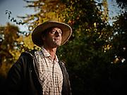 Pear farmer in california out in the pear grove shot as a Environmental Portraiture on a PhaseOne IQ180