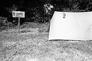 A camp set up by a no camping sign, Glastonbury, Somerset, 1989