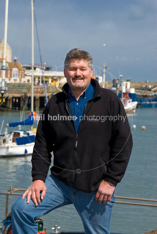 Skipper Tony Pockley on the harbour side