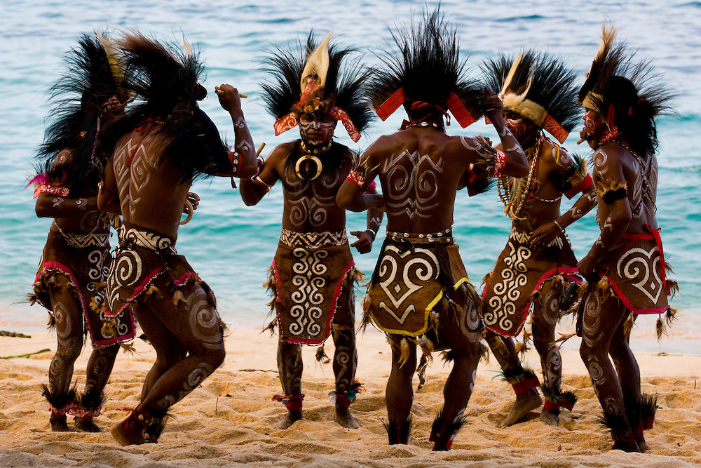 "The ""Mahai Mamuna"" war dance performed on a  beach in Jayapura, Papua, Indonesia, Sept. 15, 2008. The dance is originally from the village of Yapen on the island of Serui and symbolizes a war between the Menawi and Ambai tribes..Daniel Beltra/Greenpeace"