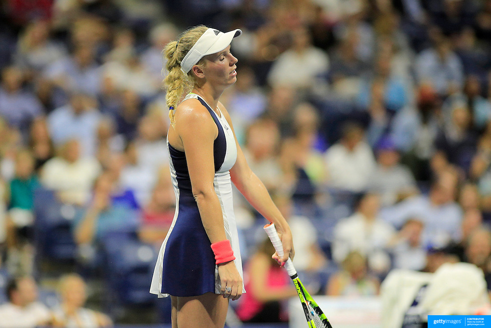 2016 U.S. Open - Day 11  Caroline Wozniacki of Denmark in action against Angelique Kerber of Germany in the Women's Singles Semifinal match on Arthur Ashe Stadium on day eleven of the 2016 US Open Tennis Tournament at the USTA Billie Jean King National Tennis Center on September 8, 2016 in Flushing, Queens, New York City.  (Photo by Tim Clayton/Corbis via Getty Images)
