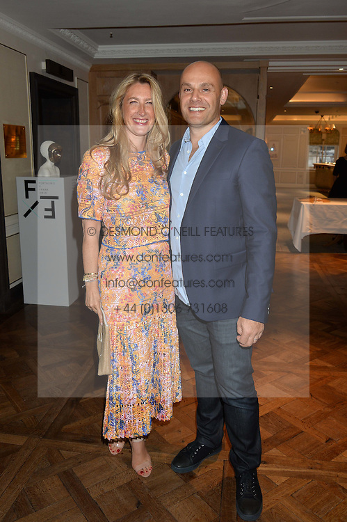 GEORGINA COHEN and her husband JONATHAN KRON at a the Fortnum's X Frank private view - an instore exhibition of over 60 works from Frank Cohen's collection at Fortnum & Mason, 181 Piccadilly, London on 12th September 2016.