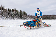 Musher Matt Failor after the restart in Willow of the 47th Iditarod Trail Sled Dog Race in Southcentral Alaska.  Afternoon. Winter.