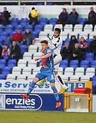 Dundee&rsquo;s Kane Hemmings outjumps Inverness&rsquo; Josh Meekings - Inverness Caledonian Thistle v Dundee at Caledonian Stadium, Inverness<br /> <br />  - &copy; David Young - www.davidyoungphoto.co.uk - email: davidyoungphoto@gmail.com