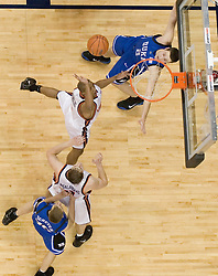 Virginia's J.R. Reynolds (2) shoots over Duke's Josh McRoberts (2) as The University of Virginia Cavaliers beat the #8 ranked Duke University Blue Devils 68-66 in overtime at the John Paul Jones Arena in Charlottesville, VA on February 1, 2007...