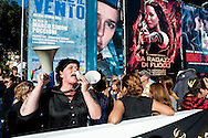 Roma 14 Novembre 2013<br /> I movimenti per la casa protestano al Film Fest all'Auditorium  per i numerosi sfratti che ci sono a Roma, e per  lo sfratto di questa mattina di Abdou la moglie con tre bambini, che dopo lo sfratto da parte della polizia non hanno ricevuto nessuna assistenza.Demonstrators for the right to housing ask to stop evictions at the Auditorium della Musica in Rome during the Film Festival