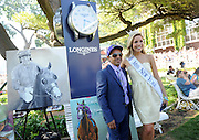 California Chrome exercise rider Willie Delgado enjoys the day as he poses with Miss New York Kira Kazantsev before the 146th Belmont Stakes, Saturday, June 7, 2014, at Belmont Park in New York.  Longines, the Swiss watchmaker known for its elegant timepieces, is the Official Watch and Timekeeper of the 146th running of the Belmont Stakes. (Photo by Diane Bondareff/Invision for Longines/AP Images)