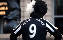 A Newcastle United fan wearing a Toon Army shirt ahead of the Premier League match at St James' Park, Newcastle.