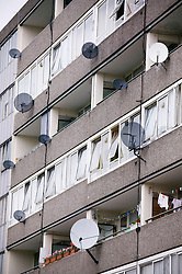 Satellite dishes on side of block of high rise flats on a council estate,