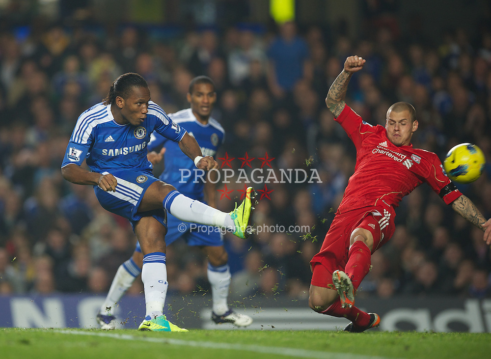 LONDON, ENGLAND - Sunday, November 20, 2011: Liverpool's Martin Skrtel tries to block a shot from Chelsea's Didier Drogba during the Premiership match at Stamford Bridge. (Pic by David Rawcliffe/Propaganda)