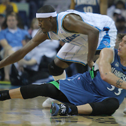 08 February 2009:  New Orleans Hornets forward James Posey (41) reaches for a loose ball as Minnesota Timberwolves guard Mike Miller (33) watches during a NBA game between the Minnesota Timberwolves and the New Orleans Hornets at the New Orleans Arena in New Orleans, LA.