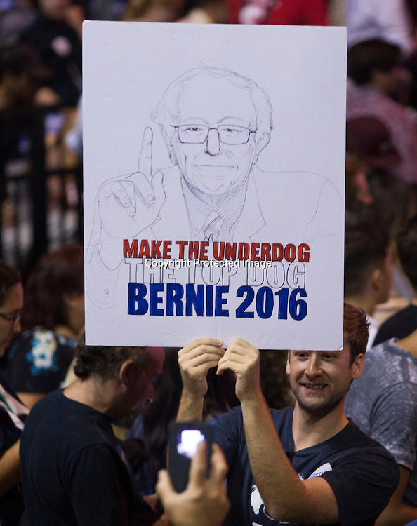 A supporter holds a sign during a rally for democratic presidential candidate Sen. Bernie Sanders, I-Vt., Monday, Aug. 10, 2015, at the Los Angeles Memorial Sports Arena in Los Angeles. (AP Photo/Ringo H.W. Chiu)