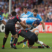 Gloucester, Great Britain, Argentina's, Tomas LAVANINI,with the ball tackled low by, Viktor KOLELISHVILI, during the Argentina vs Georgia, Pool C. game. 2015 Rugby World Cup, Venue. Kingsholm Stadium. England, Friday - 25/09/2015 <br /> [Mandatory Credit; Peter Spurrier/Intersport-images]