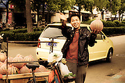chinese man; vendor of watermelons