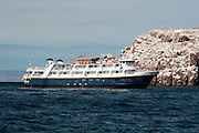 The ship, Sea Bird, lies at anchor near Los Islotes so tourists can view sea lions.