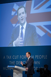 © Licensed to London News Pictures . 30/09/2013 . Manchester , UK . The British Chancellor of the Exchequer , GEORGE OSBORNE , addresses the conference this afternoon (Monday 30th September 2013) . Day 2 of the Conservative Party Conference 2013 at Manchester Central . Photo credit : Joel Goodman/LNP