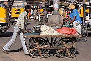 Garlic seller in street scene at Sardar Market at Girdikot, Jodhpur, Rajasthan, Northern India