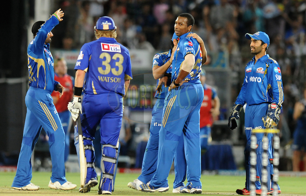Kieron Pollard of Mumbai Indians celebrate the wicket of Shane Watson of Rajasthan Royals as the latter walks back during match 72 of the Indian Premier League ( IPL) 2012  between The Rajasthan Royals and the Mumbai Indians  held at the Sawai Mansingh Stadium in Jaipur on the 20th May2012..Photo by Pal Pillai/IPL/SPORTZPICS