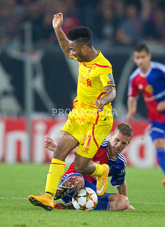 BASEL, SWITZERLAND - Wednesday, October 1, 2014: Liverpool's Raheem Sterling in action against FC Basel's Fabian Frei during the UEFA Champions League Group B match at the St. Jakob-Park Stadium. (Pic by David Rawcliffe/Propaganda)