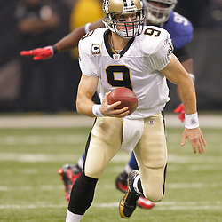 2009 October 18: New Orleans Saints quarterback Drew Brees (9) runs with the ball during a 48-27 win by the New Orleans Saints over the New York Giants at the Louisiana Superdome in New Orleans, Louisiana.