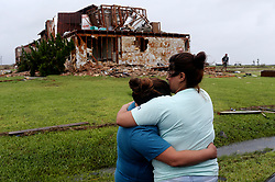 August 28, 2017 - Rockport, Texas, USA - JULIE MARTINEZ, 37, right, hugs her daughter, GABRIELLE JACKSON, 19, by the damaged apartment of her aunt at the Salt Grass Landing Apartments in Rockport, Texas, Monday. All the residents of the complex evacuated before Hurricane Harvey made landfall near the area Friday night. The units suffered major damages and residents weren't allowed access due to the dangerous conditions. (Credit Image: © San Antonio Express-News via ZUMA Wire)