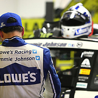 Jimmie Johnson waits for his car to get tuned in the garage during the 56th Annual NASCAR Daytona 500 practice session at Daytona International Speedway on Wednesday, February 19, 2014 in Daytona Beach, Florida.  (AP Photo/Alex Menendez)