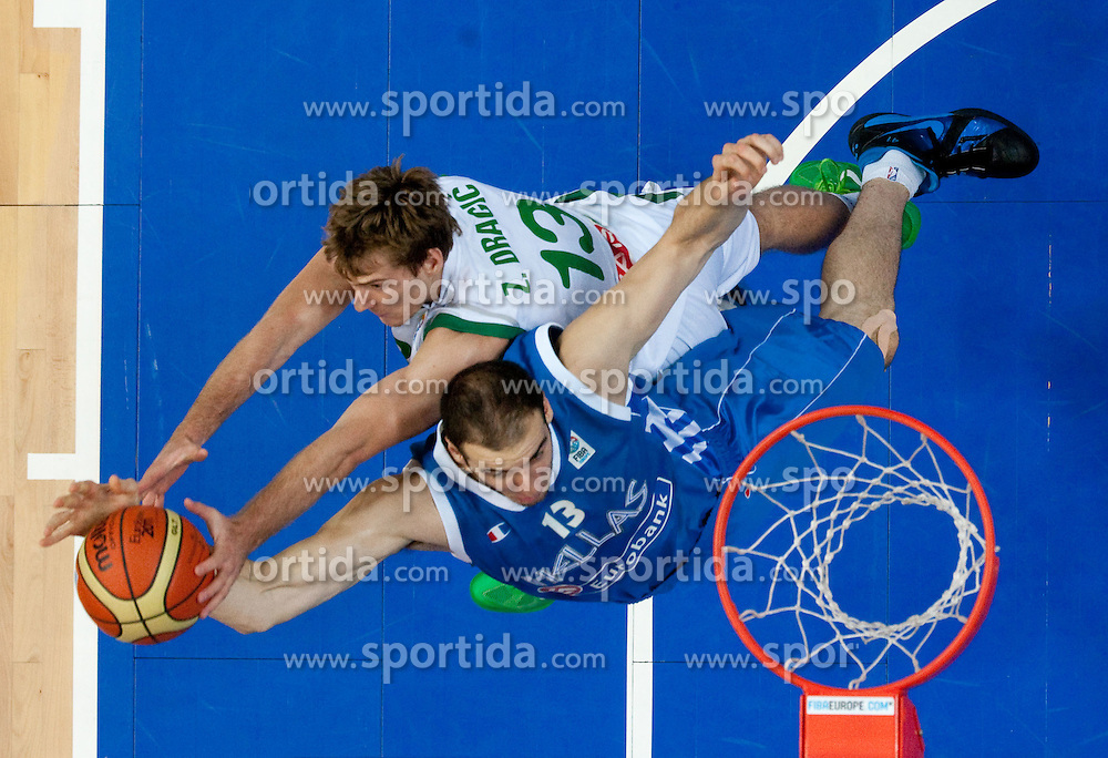 Kostas Koufos of Greece vs Zoran Dragic of Slovenia during basketball game between National basketball teams of Slovenia and Greece at FIBA Europe Eurobasket Lithuania 2011, on September 8, 2011, in Siemens Arena,  Vilnius, Lithuania. Greece defeated Slovenia 69-60.  (Photo by Vid Ponikvar / Sportida)