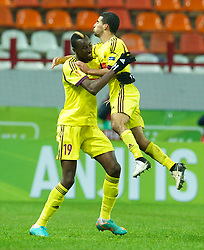 MOSCOW, RUSSIA - Thursday, November 8, 2012: FC Anji Makhachkala's Lacina Traore celebrates scoring the first goal against Liverpool with Mbark Boussoufa during the UEFA Europa League Group A match at the Lokomotiv Stadium. (Pic by David Rawcliffe/Propaganda)