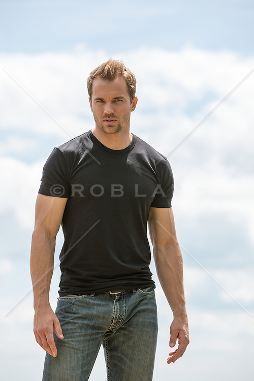 rugged and handsome All American man outdoors