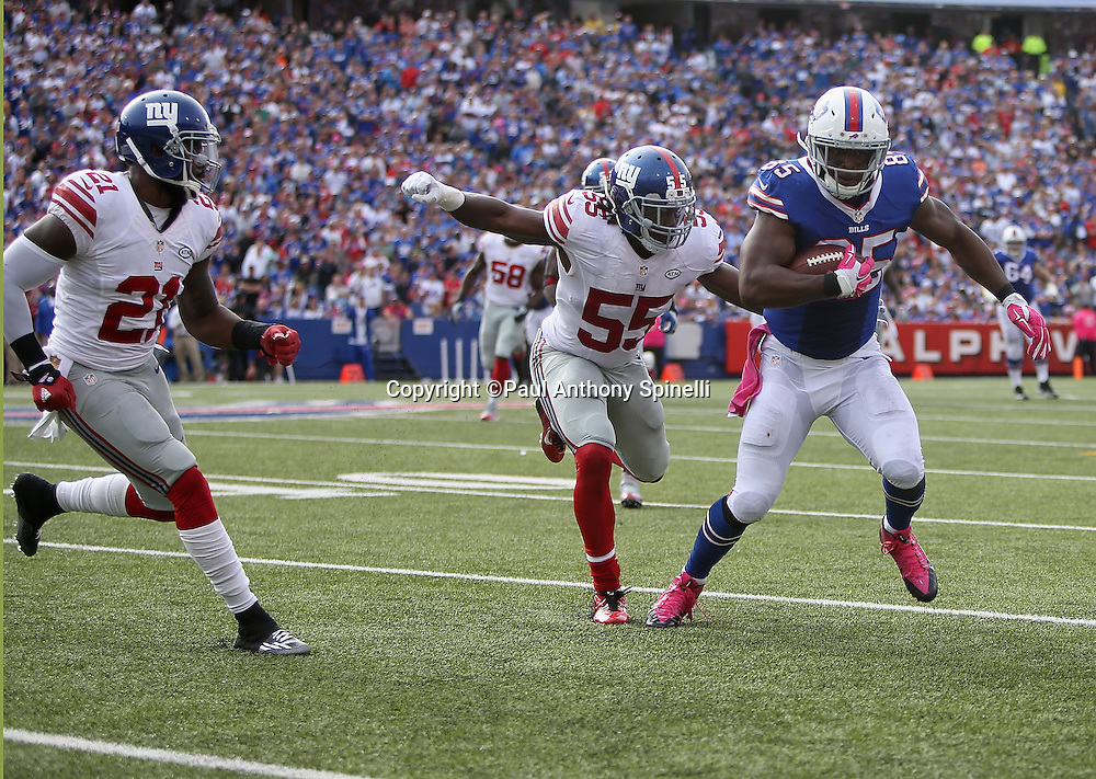 Buffalo Bills tight end Charles Clay (85) catches a first down pass at the end of the third quarter while covered by New York Giants outside linebacker J.T. Thomas (55) who unsuccessfully attempts to punch the ball loose during the 2015 NFL week 4 regular season football game against the New York Giants on Sunday, Oct. 4, 2015 in Orchard Park, N.Y. The Giants won the game 24-10. (©Paul Anthony Spinelli)
