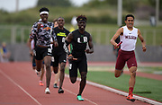 Seaver Cardoza of Long Beach Wilson (right) defeats Namir Hemphill of Upland on the anchor of the 4 x 400m relay, 3:13.86 to 3:13.97, during the 2019 CIF Southern Section Masters Meet in Torrance, Calif., Saturday, May 18, 2019.