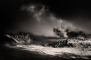 Nominated for 11th International B&amp;W Spider Awards<br /> <br /> The huge &amp; imposing massif of Yr Wyddfa (Snowdon) Wales' highest mountain. This was taken following a last minute decision to slog up Mynydd Mawr under inclement weather but it resulted in just the most fantastic hour of weather-watching from it's summit. I was utterly gripped by the continual theatrical change of light being played out across the Snowdonia hills. If it were not for my friend feeling frozen I would have braved another hour or so of just sitting and watching.