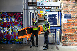 © Licensed to London News Pictures. 18/06/2018. London, UK. A policeman carries a stretcher out of Brixton Station after three bodies were discovered near Loughborough Junction station after they were reportedly hit by a train. Photo credit: Rob Pinney/LNP