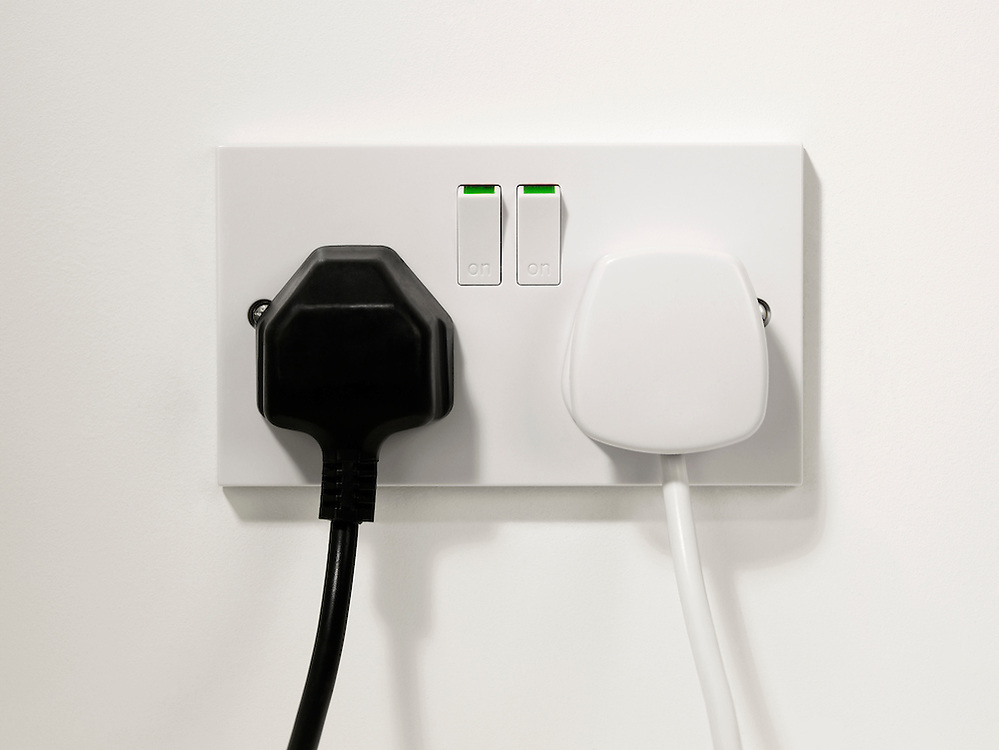 Black plug, White plug. U.K plug and Socket, wires, Plugged in.
