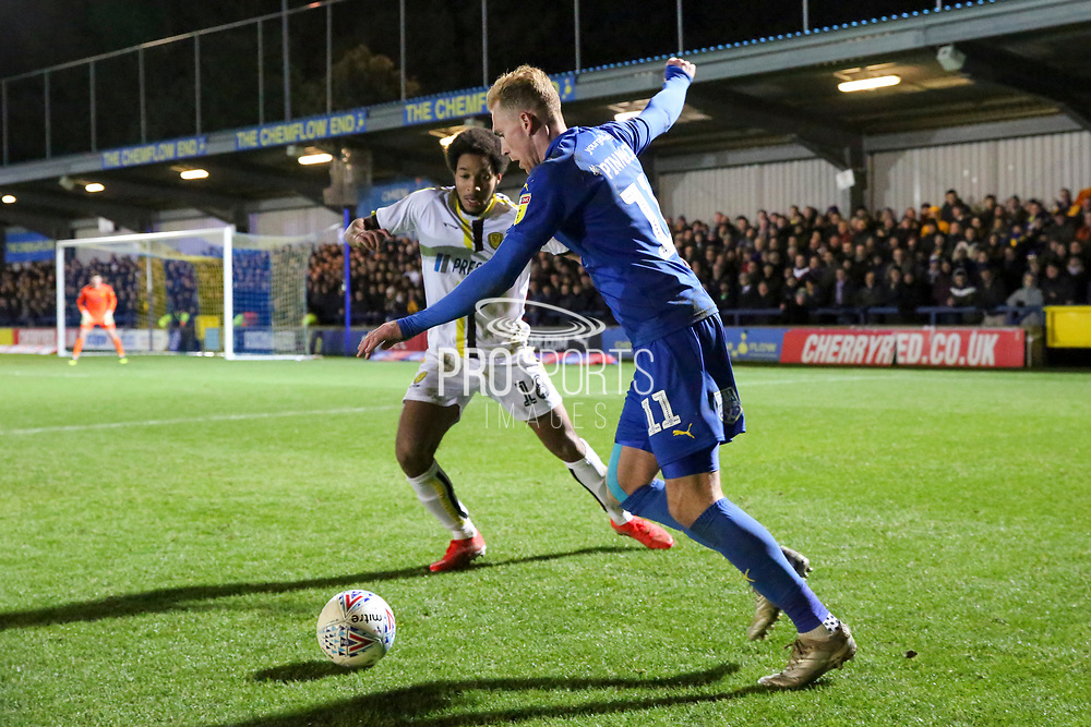 AFC Wimbledon midfielder Mitchell (Mitch) Pinnock (11) taking on Burton Albion defender Richard Nartey (18) and about to cross the ball during the EFL Sky Bet League 1 match between AFC Wimbledon and Burton Albion at the Cherry Red Records Stadium, Kingston, England on 28 January 2020.
