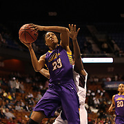 Jada Payne, (right), East Carolina, shoots while defended by Mama Traore, Temple, during the Temple Vs East Carolina Quarterfinal Basketball game during the American Women's College Basketball Championships 2015 at Mohegan Sun Arena, Uncasville, Connecticut, USA. 7th March 2015. Photo Tim Clayton