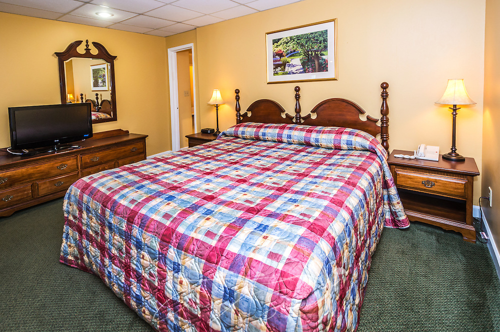 """The guest house bedroom is spacious at University Inn, a family-owned hotel located near Emory University in Atlanta, Georgia, May 29, 2014. The inn opened in January 1971 and offers 60 rooms to meet the lodging needs of University parents and other Atlanta visitors. It was featured on the Travel Channel's """"Hotel Impossible,"""" May 26, 2014. (Photo by Carmen K. Sisson/Cloudybright)"""