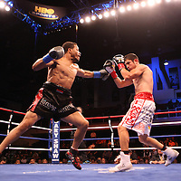 Champion Karim Mayfield (left) and Mauricio Herrera fight for the  NABO Junior Welterweight Belt during the HBO Triple Explosion fight at the Turning Stone Resort Casino in Verona, NY, on Saturday, Oct 27, 2012. (AP Photo/Alex Menendez)