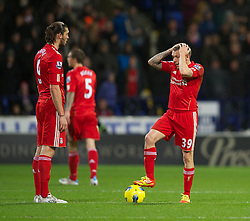 BOLTON, ENGLAND - Saturday, January 21, 2011: Liverpool's Craig Bellamy looks dejected as Bolton Wanderers score the second goal during the Premiership match at the Reebok Stadium. (Pic by David Rawcliffe/Propaganda)