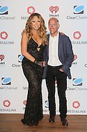 CAP D'ANTIBES, FRANCE - JUNE 17:  Mariah Carey AND William Eccleshare – CEO of Clear Channel Outdoor attend Clear Channel Media And Entertainment And MediaLink Dinner at Hotel du Cap-Eden-Roc on June 17, 2014 in Cap d'Antibes, France.  (Photo by Tony Barson/Getty Images for Clear Channel)