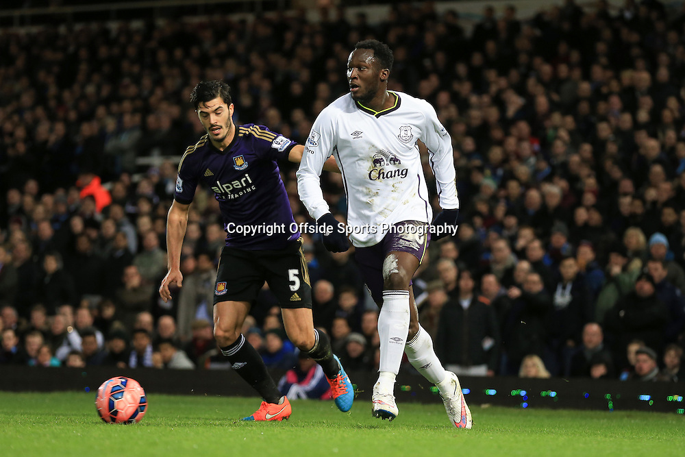 13 January 2015 - The FA Cup 3rd Round (Replay)  - West Ham v Everton - Romelu Lukaku of Everton in action with James Tomkins of West Ham - Photo: Marc Atkins / Offside.