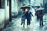 Children running in the rain, Suzchou, China