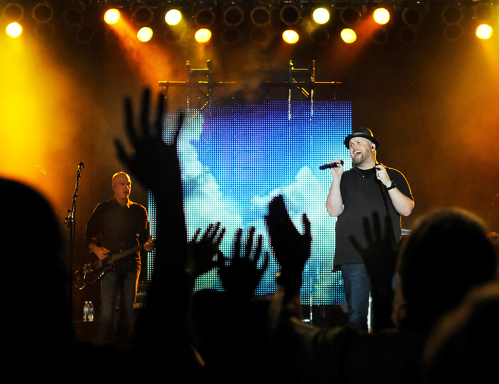 """Hands fill the air during Mercy Me's performance of """"I Can Only Imagine"""" during the second day of the Unity Christian Music Festival at Heritage Landing in Muskegon, Mich., on Aug. 6, 2009."""