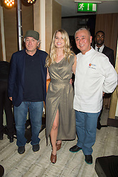 Left to right, ROBERT DE NIRO, ALICE EVE and NOBU MATSUHISA at a party to celebrate the 10th anniversary of Nobu Berkeley Street held on 5th November 2015.