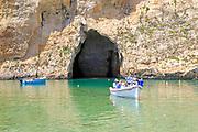 Boat trip at the Inland Sea tourist attraction, Dwerja Bay, island of Gozo, Malta