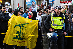 London, UK. 10th June, 2018. A Hezbollah flag among hundreds of people taking part in the pro-Palestinian Al Quds Day march through central London organised by the Islamic Human Rights Commission. An international event, it began in Iran in 1979. Quds is the Arabic name for Jerusalem.